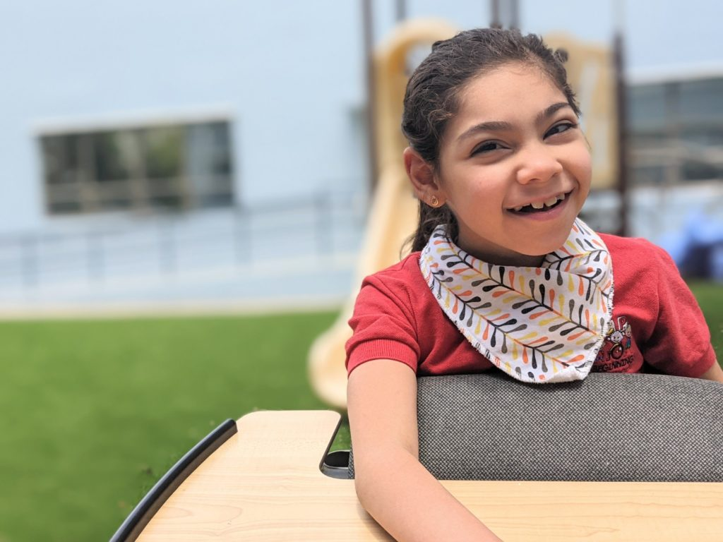Girl smiling and playing outside